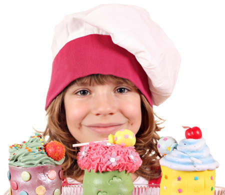little girl cook with cupcakes portrait photo