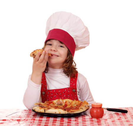 hungry little girl cook eat pizza photo
