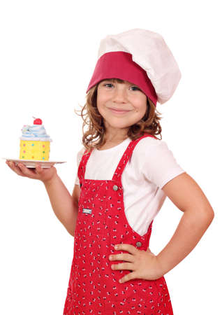 happy little girl cook with sweet colorful cupcake Standard-Bild