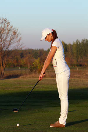 girl golf player preparing for shot photo