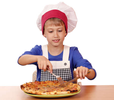 hungry boy chef eat pizza photo