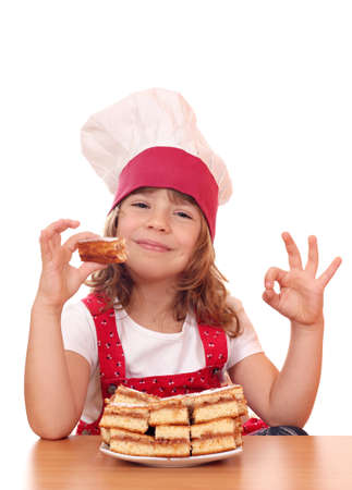 little girl cook with ok hand sign and apple cakes photo