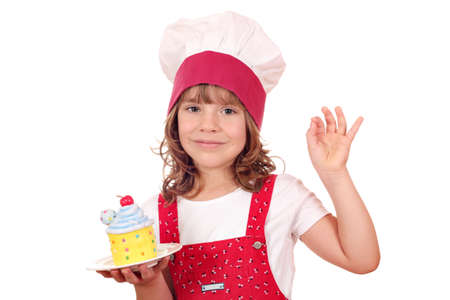 little girl cook with cupcake and ok hand sign photo