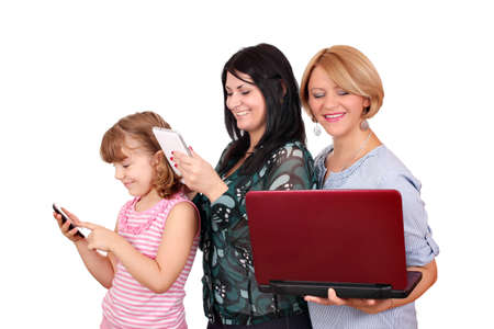 three generations girls with smart phone tablet and laptop photo