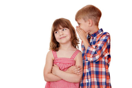 boy whispering a secret little girl on white  photo