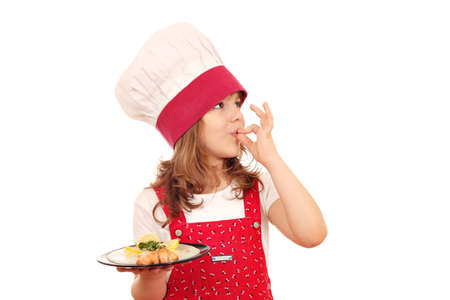 prepared fish: little girl cook with salmon and ok hand sign Stock Photo