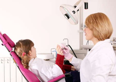 scared little girl and dentist photo