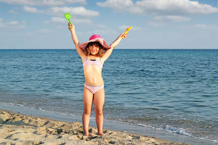 happy little girl on beach Stock Photo