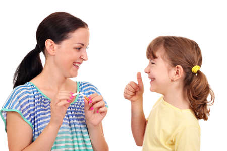 girl breaks a cigarette and a little girl with thumb up  Stock Photo