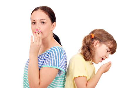 meisje hoesten als gevolg van roken Stockfoto