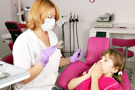 little girl is afraid of the dentist  photo