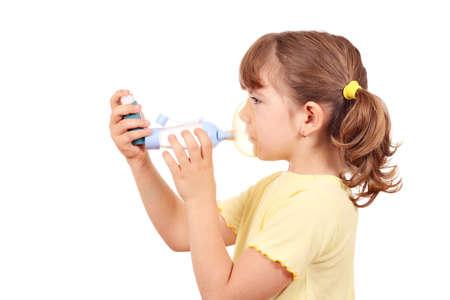 little girl with asthma inhaler photo