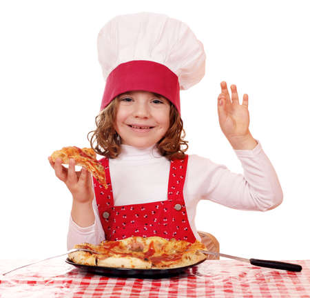 happy little girl cook with pizza and ok hand sign photo