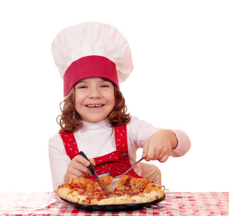 little girl cook eating pizza photo