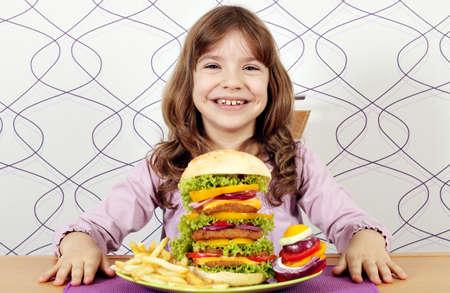 happy little girl with big hamburger photo