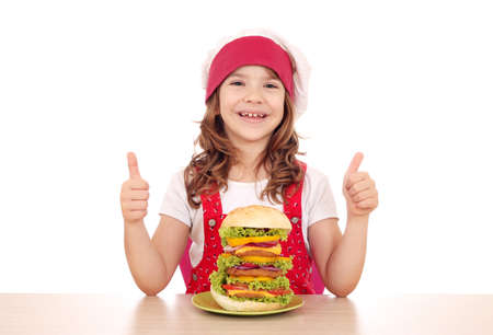 happy little girl cook with big hamburger and thumbs up photo