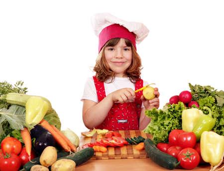 happy little girl cook peeling potatoes photo