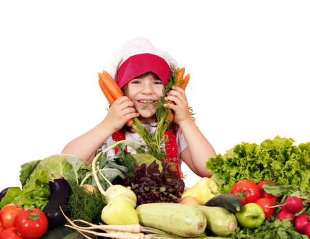 happy little girl cook with vegetables photo
