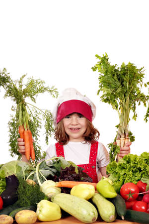 happy little girl with carrots and vegetables photo
