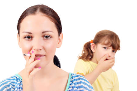 smoking cigar: girl smoking cigarette and little girl coughs