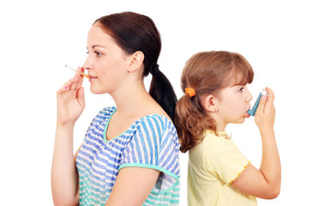women smoking: girl smoking cigarette and little girl use inhaler