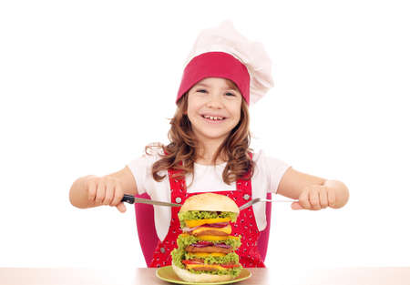 happy little girl cook with big hamburger photo