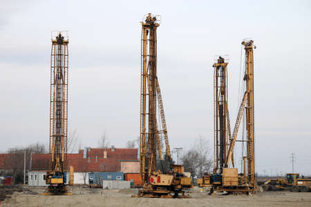 four hydraulic drilling machines on construction site Stock Photo