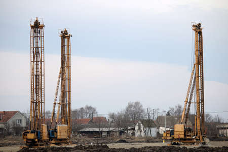 boring rig: three hydraulic drilling machines on construction site Stock Photo