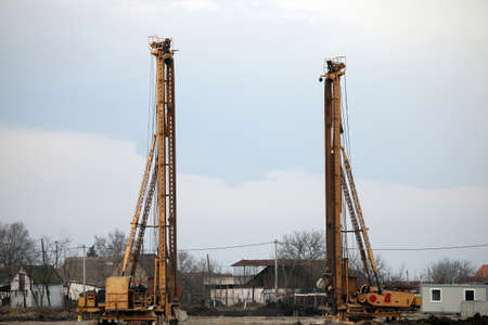 two hydraulic drilling machines on construction site photo