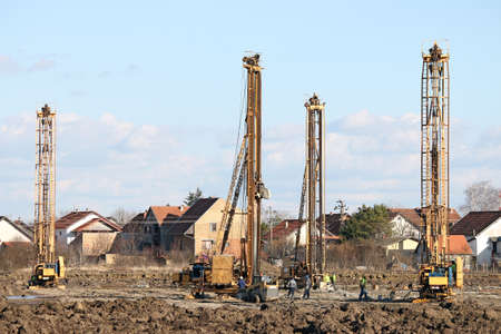 boring rig: workers and four hydraulic drilling machines on construction site
