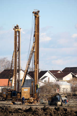 construction site with workers and hydraulic drilling machines photo