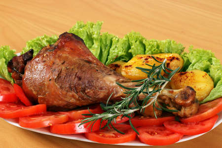 drumstick: drumstick with vegetables on plate Stock Photo