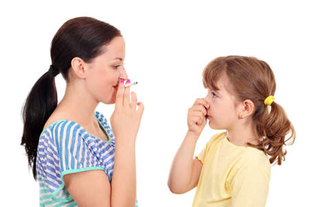 women smoking: Smoking can cause asthma and diseases in children Stock Photo