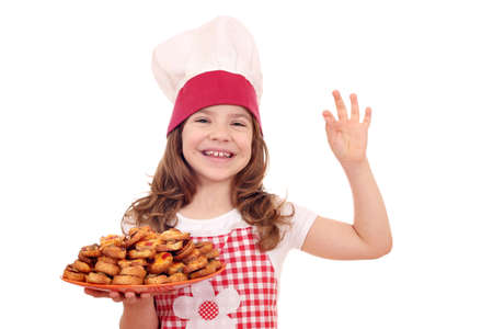 happy little girl cook with bruschette and ok hand sign photo