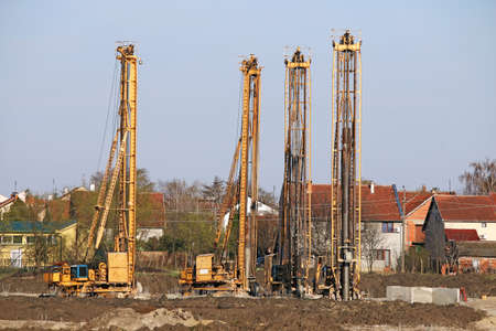 boring rig: construction site with four hydraulic drilling machines