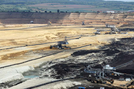 open pit: heavy excavators working on open pit coal mine