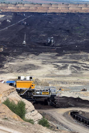 machinery: open pit coal mine with machinery and excavators