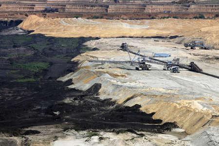 open pit: excavators working on open pit coal mine