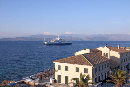 ferry boat: ferry boat sailing near old Corfu town Greece