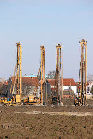 boring rig: four hydraulic drilling machines on construction site industry Stock Photo