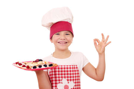 ok: happy litle girl with crepes on plate and ok hand sign Stock Photo