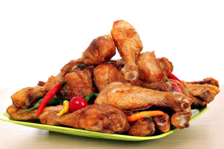 food       plate: roasted chicken drumsticks on plate