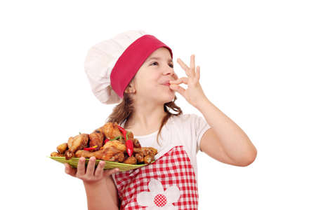 ok: happy little girl cook with chicken drumstick and ok hand sign Stock Photo