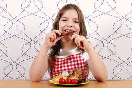meat grill: hungry girl eating chicken wings