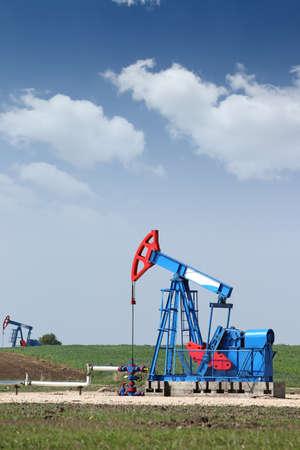 nodding: two oil pump jack on field