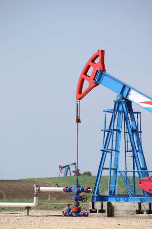 jacks: oil pump jacks on oilfield Stock Photo
