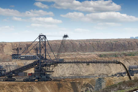 open pit: excavator working on open pit coal mine