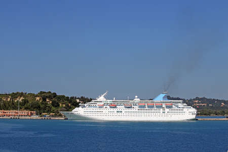cruiser: large cruiser ship in port Corfu island Greece