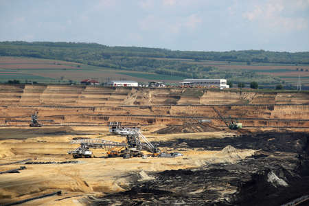 open pit coal mine with machinery mining industry