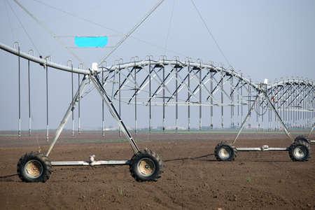 pivot: center pivot sprinkler system on field agriculture Stock Photo